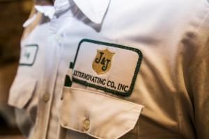 J&J Exterminating badge on pest control operator's shirt